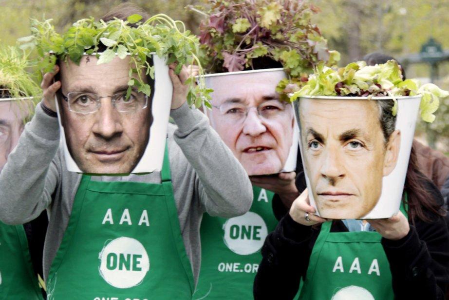 Des activistes de l'ONG One -organisation luttant contre... (Photo: Charles Platiau, Reuters)