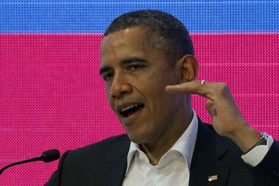 Barack Obama, qui a divulgué vendredi, comme chaque... (Photo : Cris Bouroncle, AFP)