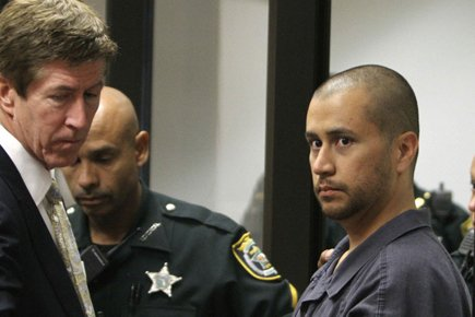 L'avocat Mark O'Mara et son clientGeorge Zimmerman en... (Photo: Reuters)