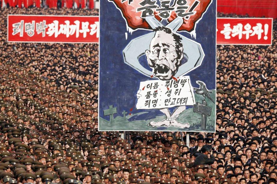 La foule criait «Mettons en pièces la bande... (Photo: Ng Han Guan, AP)