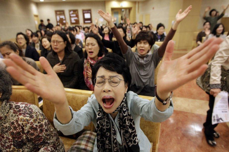 «Nous allons prier Dieu afin que le concert... (Photo Lee Jin-man, AFP)