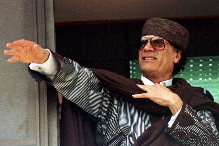 Le défunt dirigeant libyen Mouammar Kadhafi est toujours... (Photo: Archives AP)