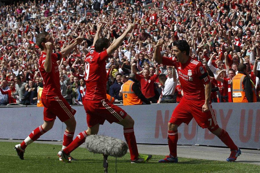 Jordan Henderson, Stewart Downing et Luis Suarez, du... (Photo: Reuters)