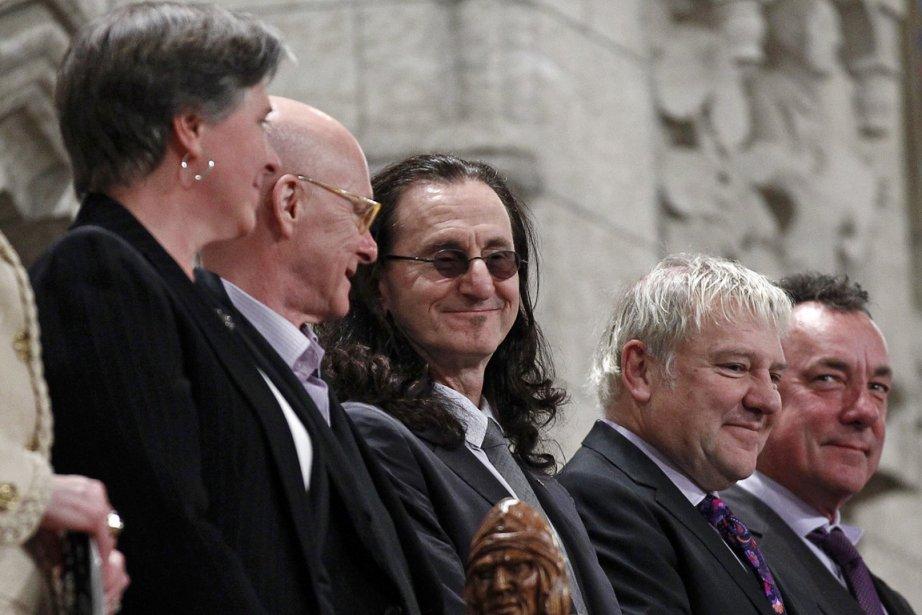 Du milieu jusqu'à la droite, Geddy Lee, Alex... (Photo : Chris Wattie, Reuters)