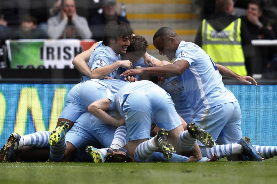 Manchester City est à égalité de points avec... (Photo : David Moir, Reuters)