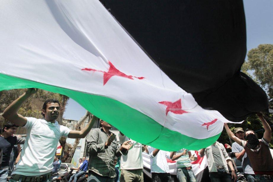 Des opposants au régime du président syrien Bachar... (Photo: AP)