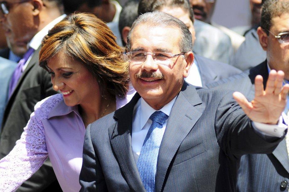 En obtenant 51,21% des voix dimanche, Danilo Medina,... (Photo: Ricardo Rojas, Reuters)