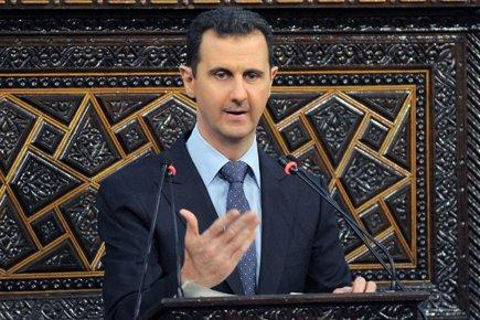 Bachar al-Assad a accusé dimanche l'étranger de mener... (Photo: AFP)