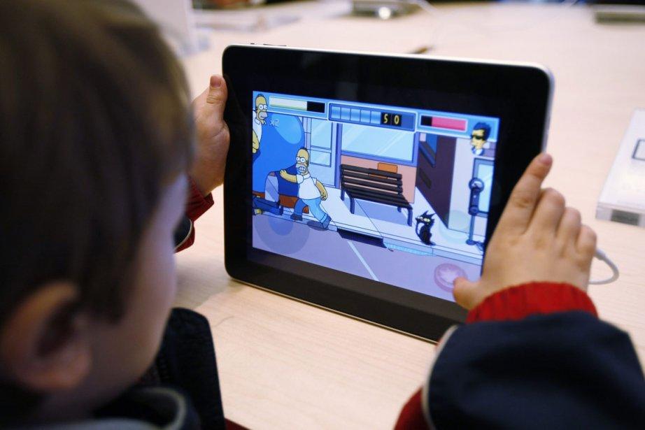 Sur cette photo, l'iPad d'Apple.... (Photo AP)