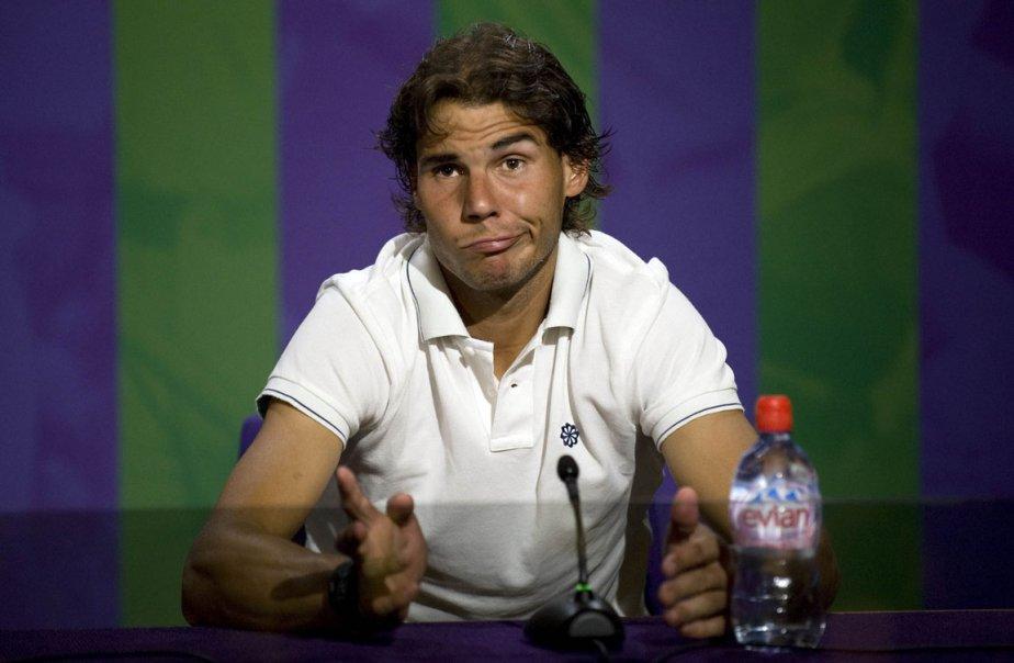 L'espagnol Rafael Nadal répond à la question d'un journaliste suit à son élimination surprise du tournoi de tennis de Wimbledon | 29 juin 2012