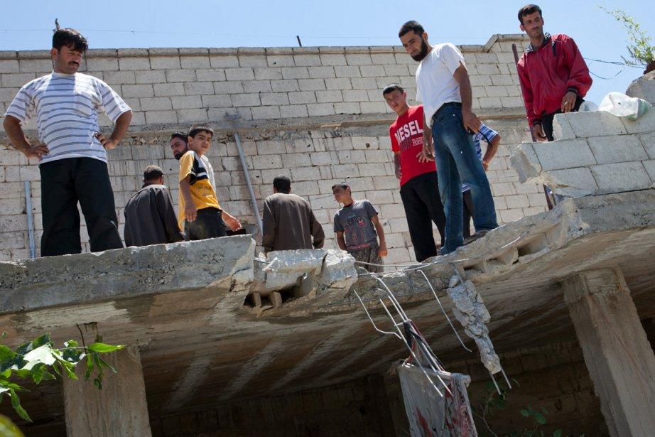 Pendant ce temps, la population de la Syrie... (Photo Reuters)