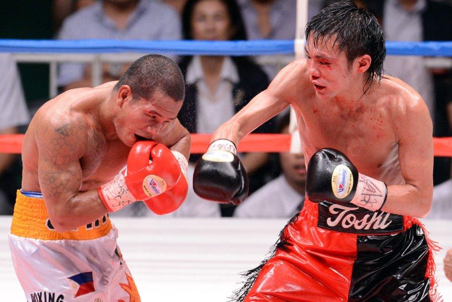 Toshiyuki Igarashi (à droite) a vaincu le champion... (Photo : Toshifumi Kitamura, AFP)
