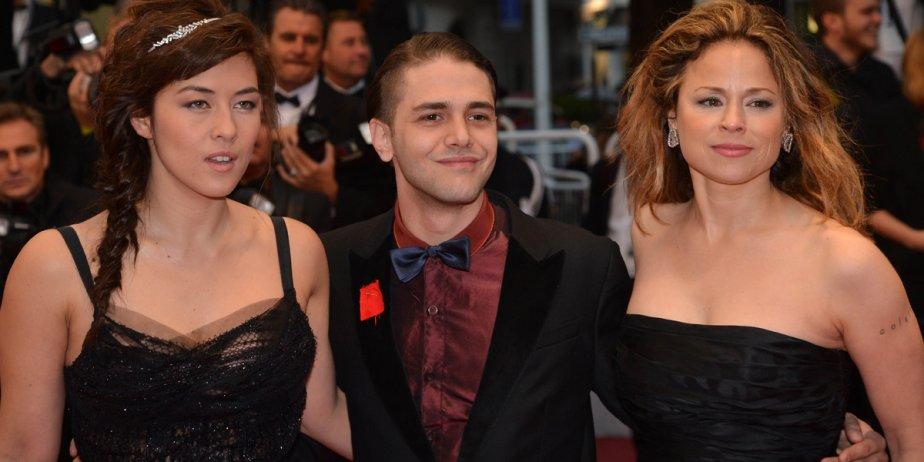 Xavier Dolan accompagné de Mylène Jampanoï à gauche... (AFP)