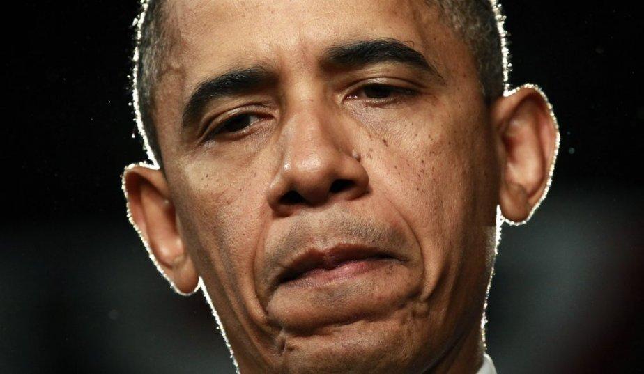 Le visage du président Barack Obama en dit long... | 20 juillet 2012
