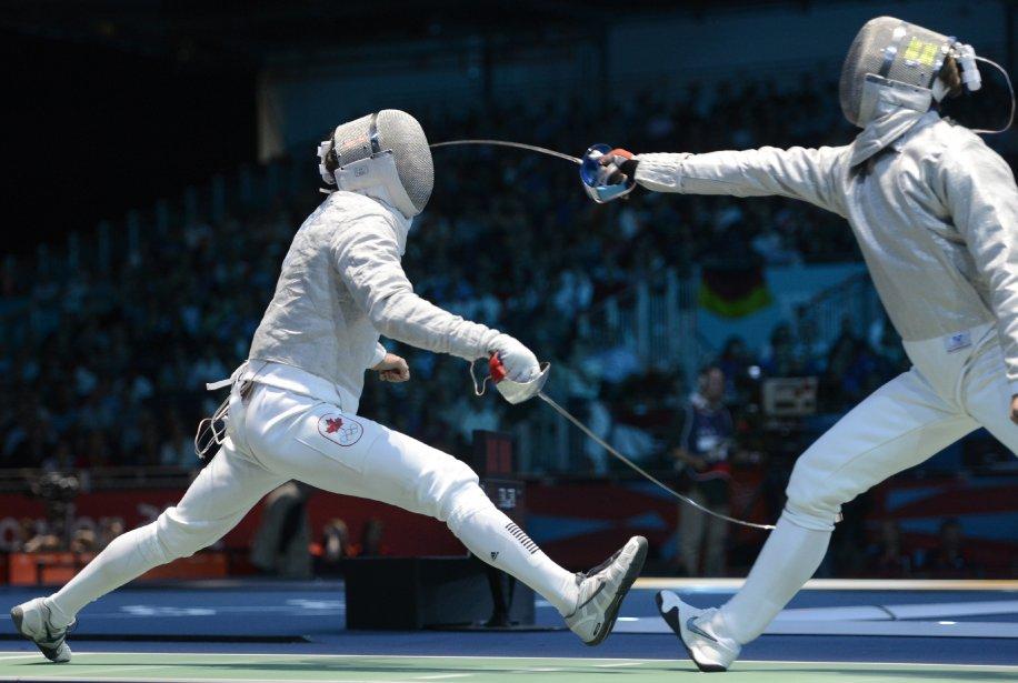 Escrime-sabre: Philippe Beaudry (à gauche) a perdu son duel face à Dimitri Lapkes. | 29 juillet 2012