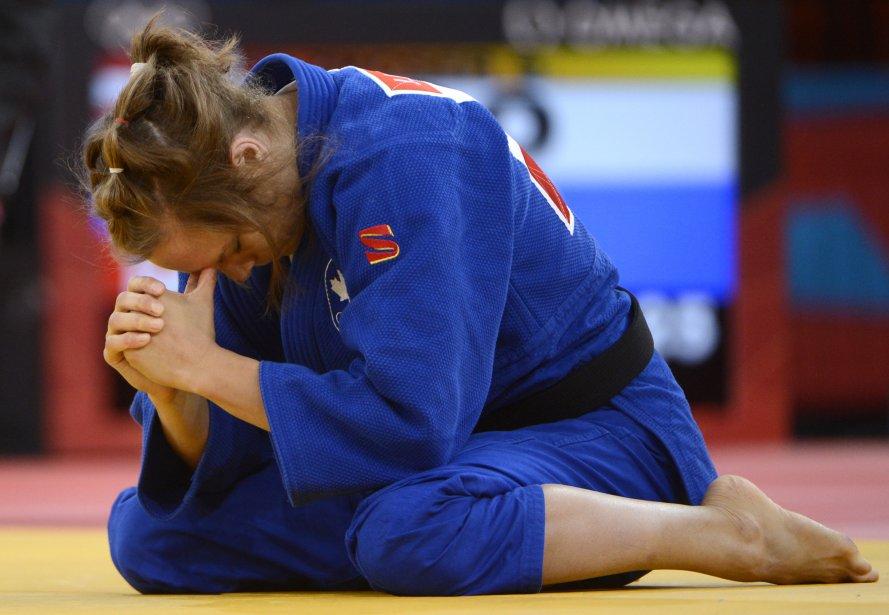 La judoka québécoise Joliane Melançon a perdu son premier combat par immobilisation contre l'Autrichienne Sabrina Filzmoser (-57 kg). | 30 juillet 2012
