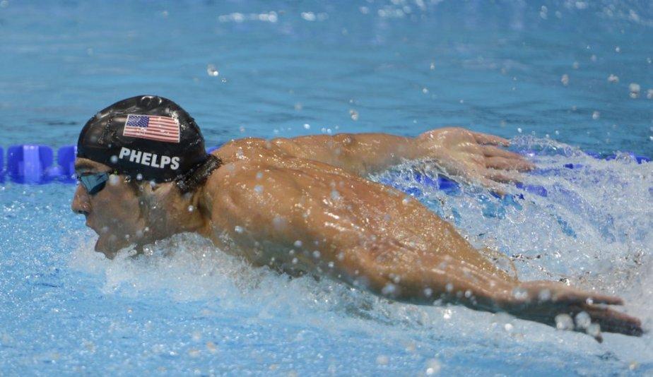 Michael Phelps est devenu l'athlète le plus médaillé de l'histoire des Jeux olympiques en remportant ses 18e et 19e médailles. | 31 juillet 2012