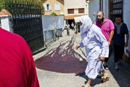 Une flaque de sang de porc était visible... (Photo: Reuters)