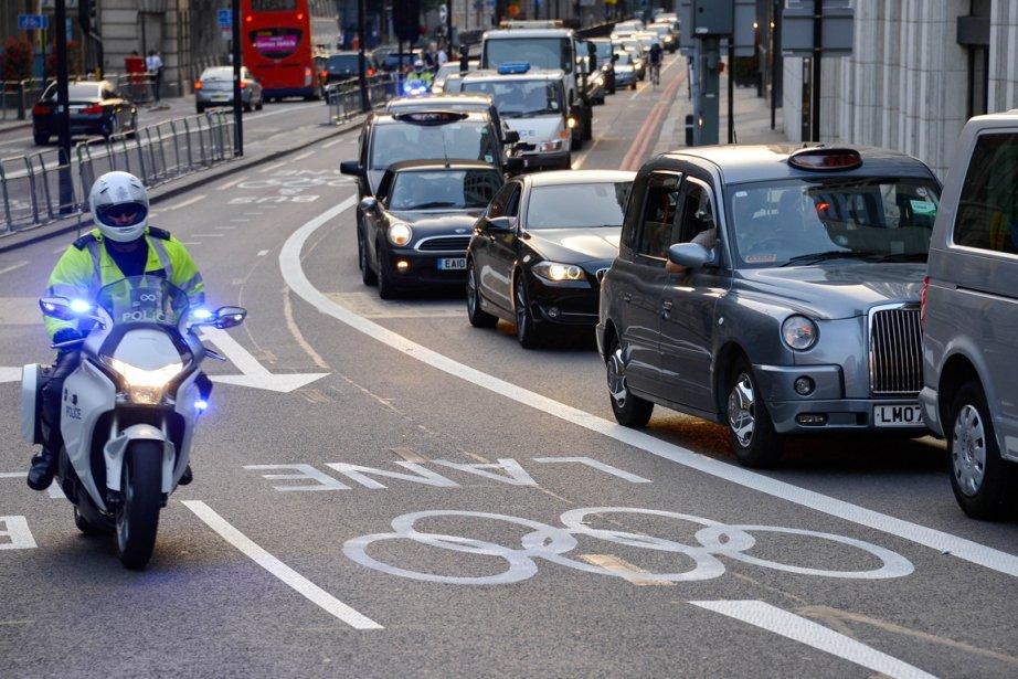 Les black cabbies, ces conducteurs des emblématiques taxis... (PHOTO FABRICE COFFRINI, ARCHIVES AFP)