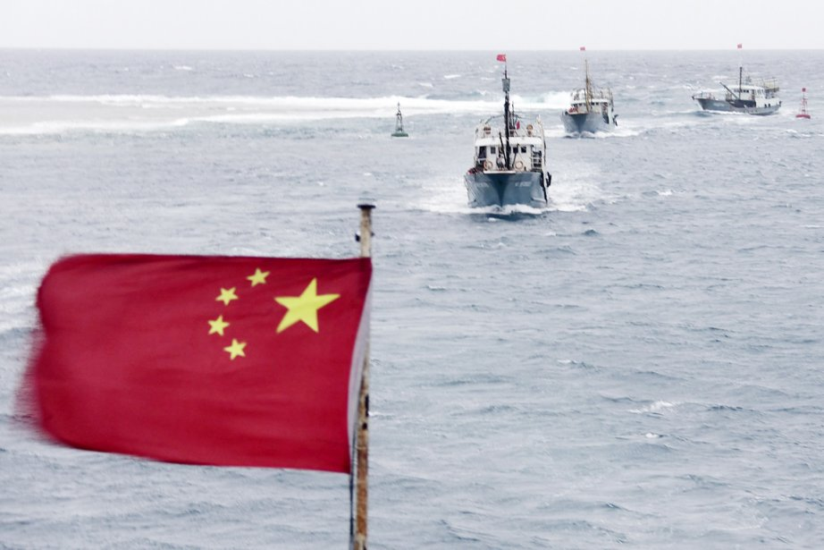 Des navires chinois au large de la province... (PHOTO AP)