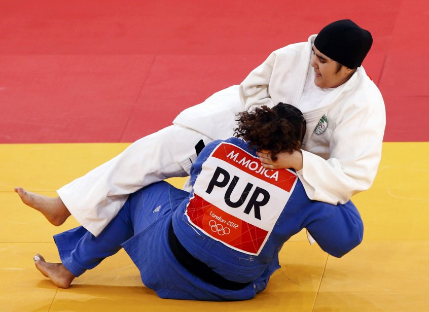 La Saoudienne Wojdan Shaherkani est devenue la première femme a représenté l'Arabie Saoudite aux Jeux olympiques quand elle a été battu par la Portoricaine Melissa Mojica. | 3 août 2012