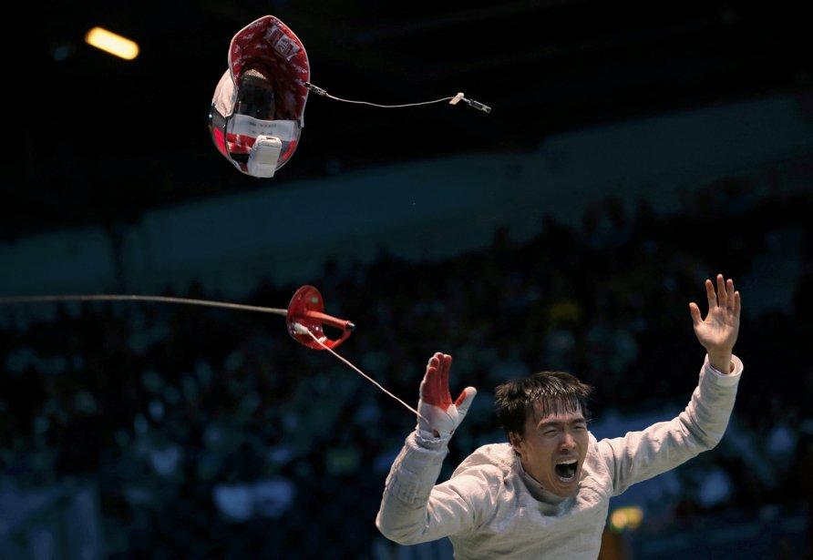 Le Sud-Coréen Woo Young Won célèbre pendant son match contre l'Allemand Nicolas Limbach. | 3 août 2012