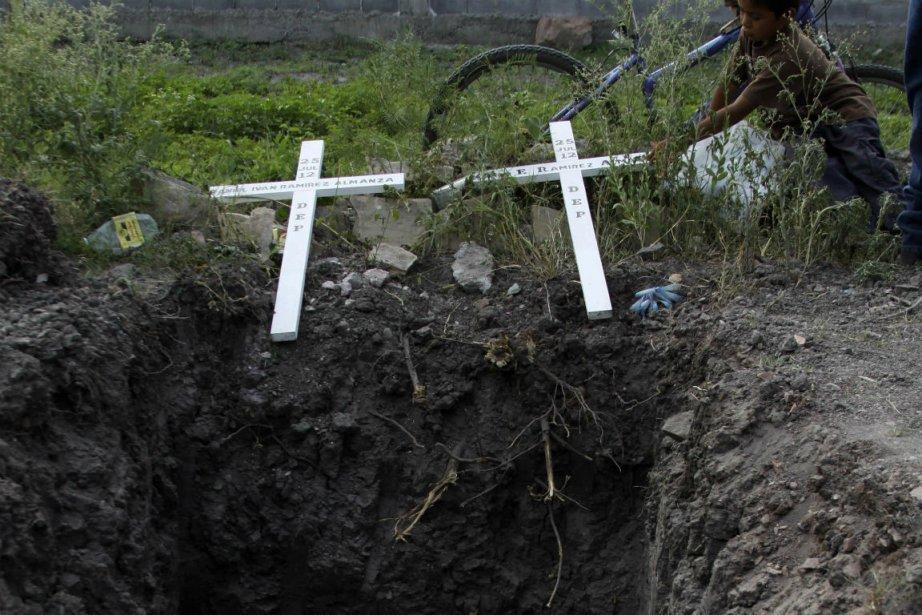 Cinq mineurs ont été trouvés morts et un... (PHOTO REUTERS)