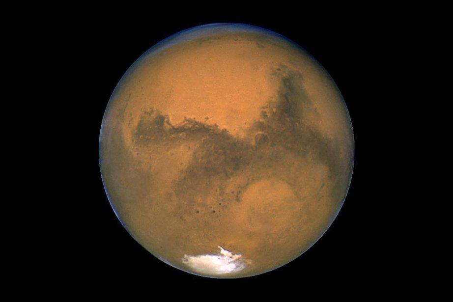 La planète Mars, photographiée par le télescope Hubble,... (Photo: archives NASA)