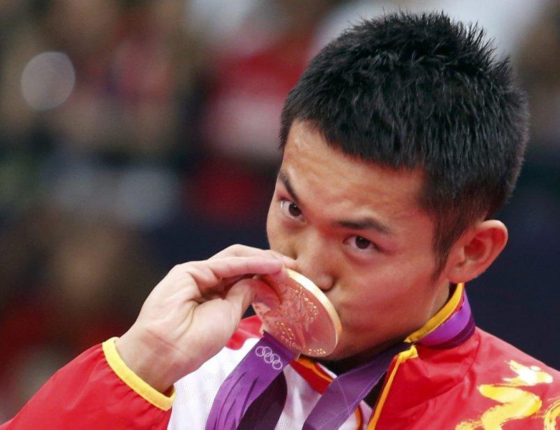 La Chine a confirmé son écrasante domination en badminton en signant le grand chelem aux Jeux de Londres, le premier jamais réalisé aux JO, avec les victoires de Lin Dan (ci-haut) en simple et de Cai Yun et Fu Haifeng en double. | 5 août 2012