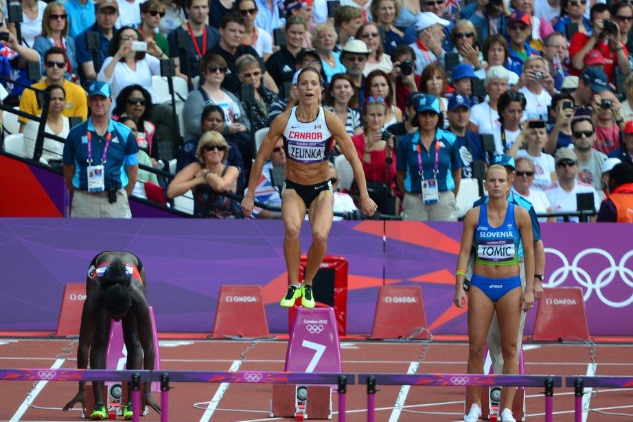 La Canadienne Jessica Zelinka (au centre) se prépare à prendre le départ du 100 m haies. | 6 août 2012