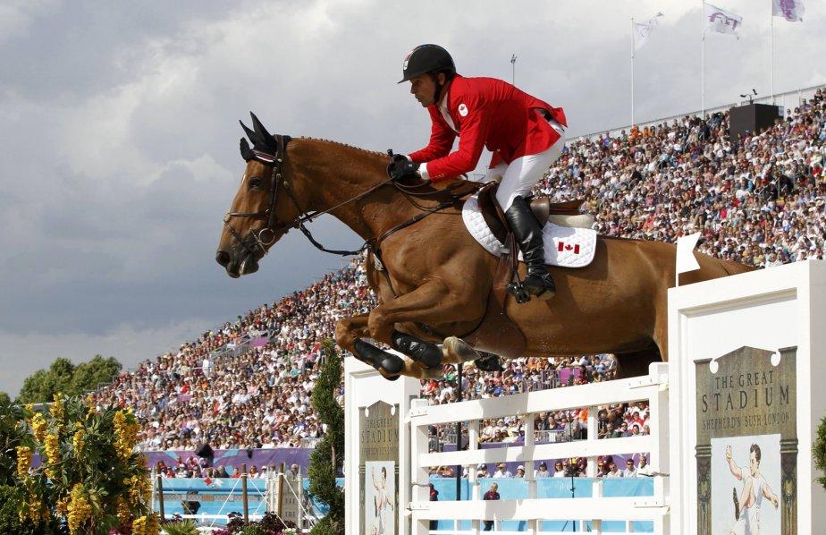 Eric Lamaze, sur son cheval Derly Chin De Muze, a terminé 22e à la 3e épreuve qualificative du saut d'obstacles - individuel. | 6 août 2012