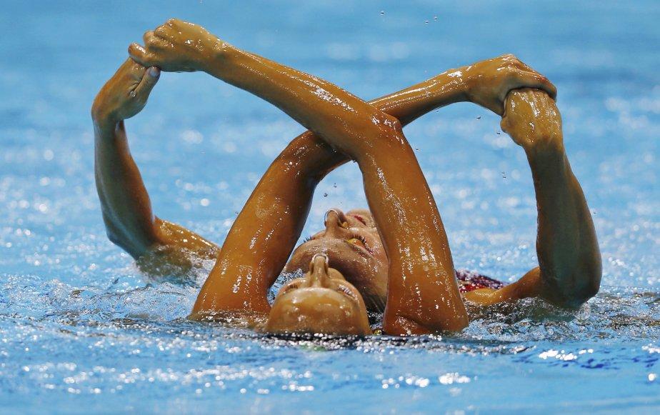 Les Québéoises Marie-Pier Boudreau Gagnon et Elise Marcotte ont terminé 4e en qualification au programme libre en natation synchronisée en duo. | 6 août 2012