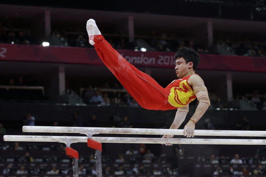 Le gymnaste chinois Feng Zhe a été sacré champion olympique aux barres parallèles. | 7 août 2012