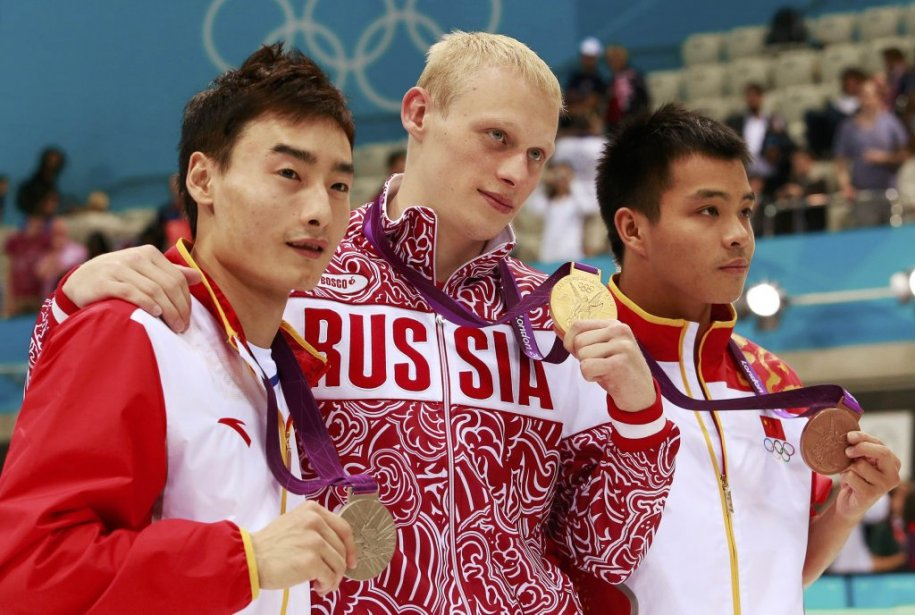 Le plongeur russe Ilya Zakharov (au centre) a coiffé les Chinois Qin Kai et He Chong pour rafler l'or au tremplin de 3 mètres. | 7 août 2012