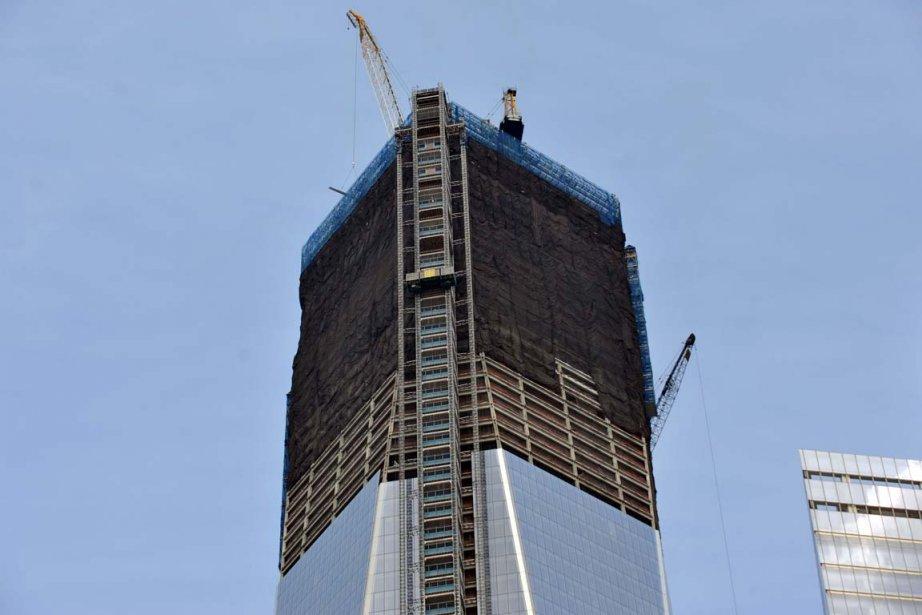 Les travaux de construction se poursuivent sur les... (PHOTO STAN HONDA, AGENCE FRANCE-PRESSE)