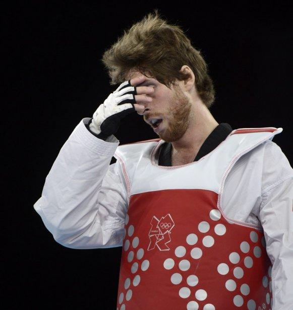 Le Québécois Sébastien Michaud a subi la défaite contre l'Arménien Arman Yeremyan à son premier combat lors du tournoi de taekwondo. | 10 août 2012