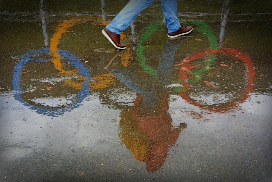 La pluie n?a pas refroidi les ardeurs des spectateurs venus assister aux Jeux. | 14 août 2012
