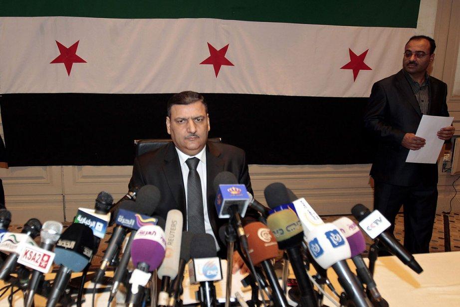 Le premier ministreRiad Hijab (ici, lors d'une conférence... (Photo Khalil Mazraawi, AFP)