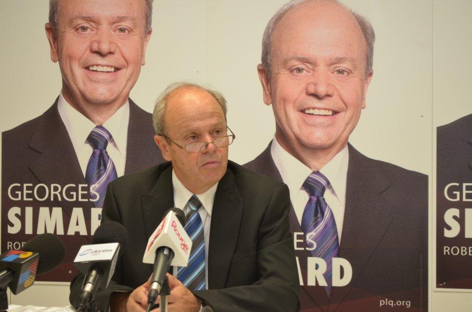 Le candidat libéral Georges Simard vante les réalisations de... (Louis Potvin)