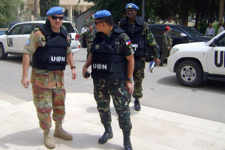 Des observateurs de l'ONU dans la ville de... (Photo Syrian Arab News Agency/AFP)