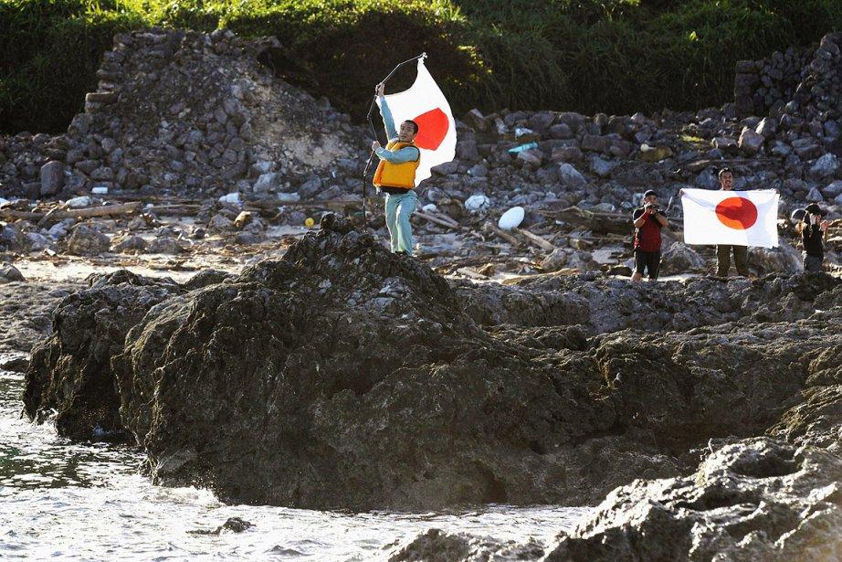 Une dizaine de nationalistes ont débarqué sur Uotsurijima,... (Photo: Reuters)