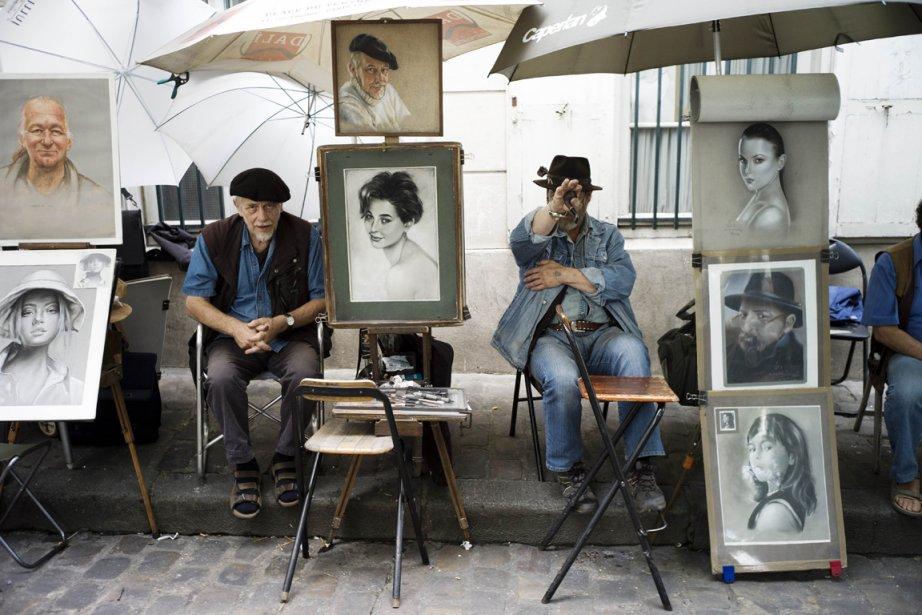 Des peintres dans le quartier Montmartre, à Paris.... (Photo Fred Dufour, AFP)