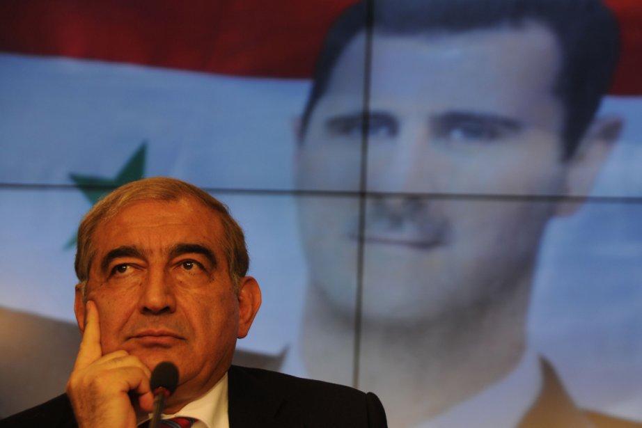 Le vice-premier ministre syrien Qadri Jamil à une... (PHOTO ANDREY SMIRNOV, AFP)