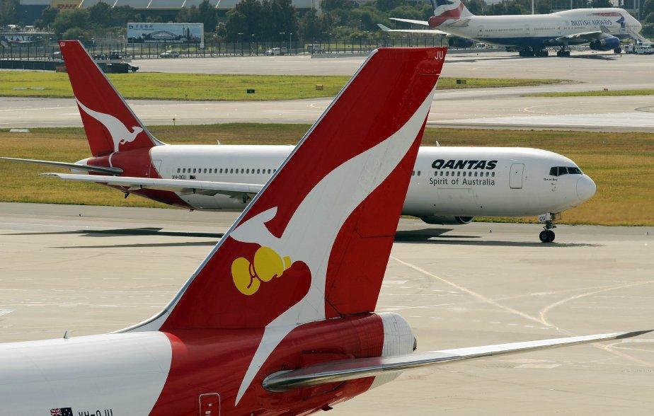 Qantas Airways aannoncé jeudi une perte nette annuelle... (PHOTO AFP)