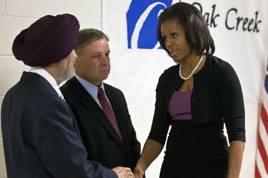 Un représentant de la communauté Sikh, le maire... (PHOTO AP)