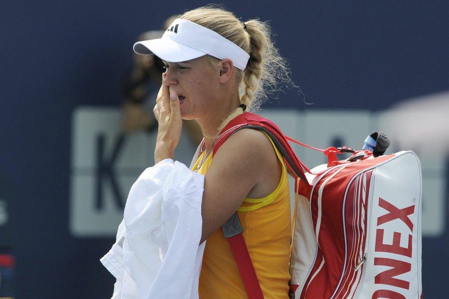 Caroline Wozniacki s'était blessée au genou en quarts... (Photo : Fred Beckham, AP)