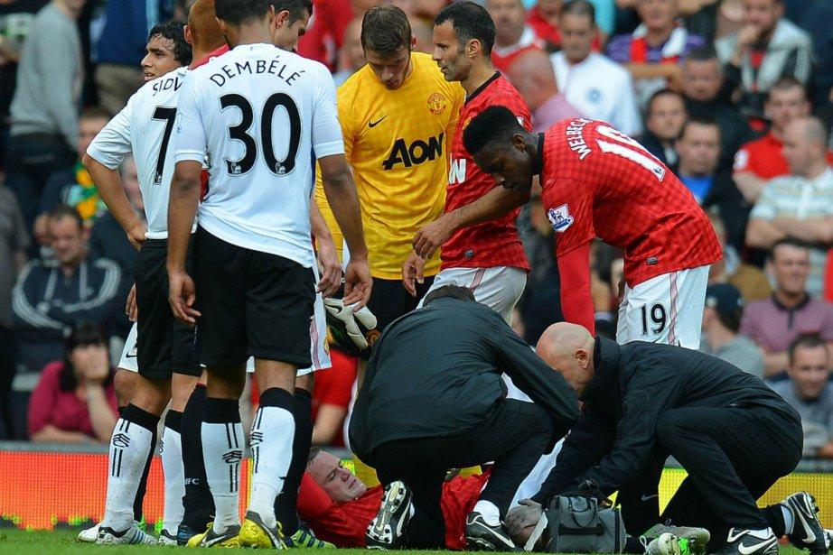 Wayne Rooney s'est blessé au genou droit.... (Photo Andrew Yates, Agence France-Presse)