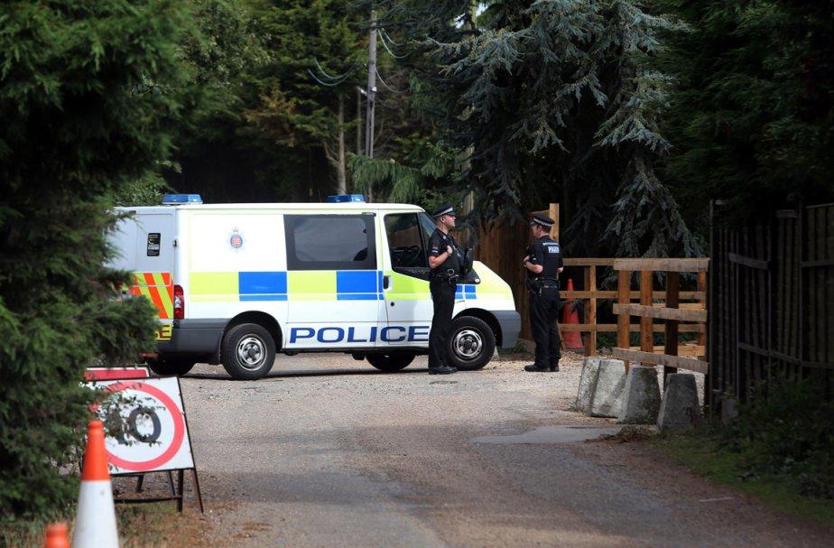 La police s'est déployée dans le village de... (Photo: AP)
