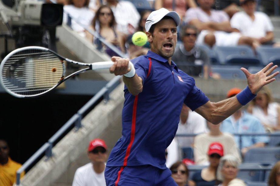 Novak Djokovic n'a échappé que 14 jeux en... (Photo : Mel Evans, AP)