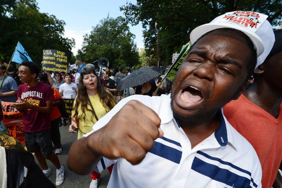 La manifestation, qui a réuni au moins 300... (Photo AFP)